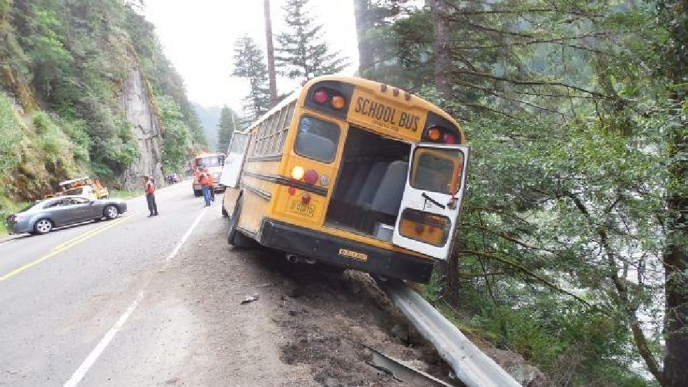 School bus crashes into guardrail along cliff above river