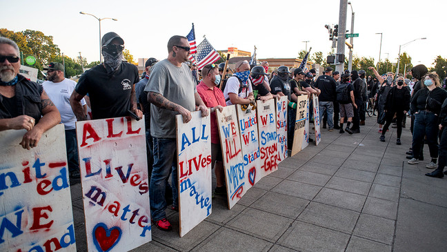 Approximately 100 All Lives Matter counter protesters confronted an estimated 300 pro-Black Lives Matter protesters in front of the Eugene federal courthouse Saturday afternoon. The confrontation quickly turned violent, resulting in several fist fights and one man with the All Lives Matter group discharging his sidearm. Photo by Dan Morrison